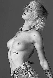 Ireland Baldwin sexy, topless and naked