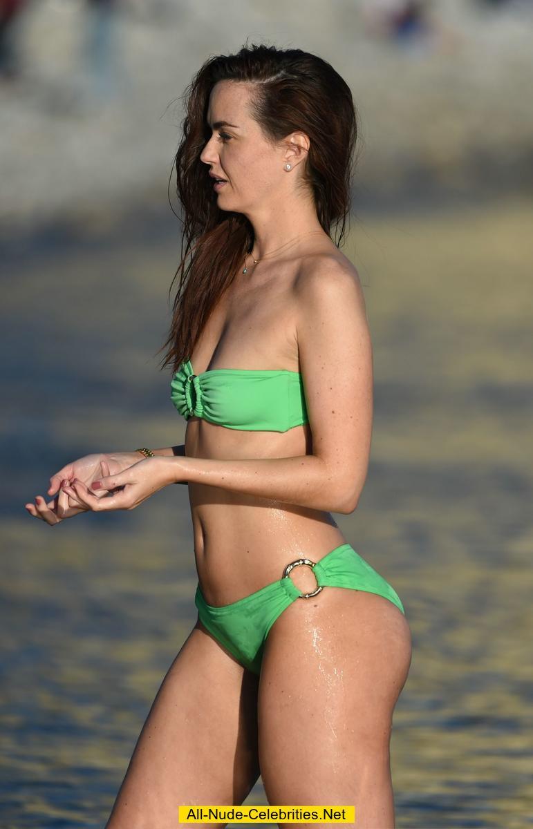 Jennifer Metcalfe in green bikini on a beach