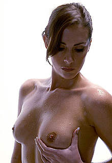 Katie Green shows nude tits and shaved pussy