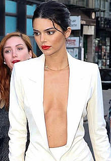 Kendall Jenner without bra under white jacket