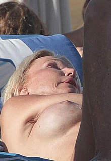 Lauren Foster sunbathing topless paparazzi pix