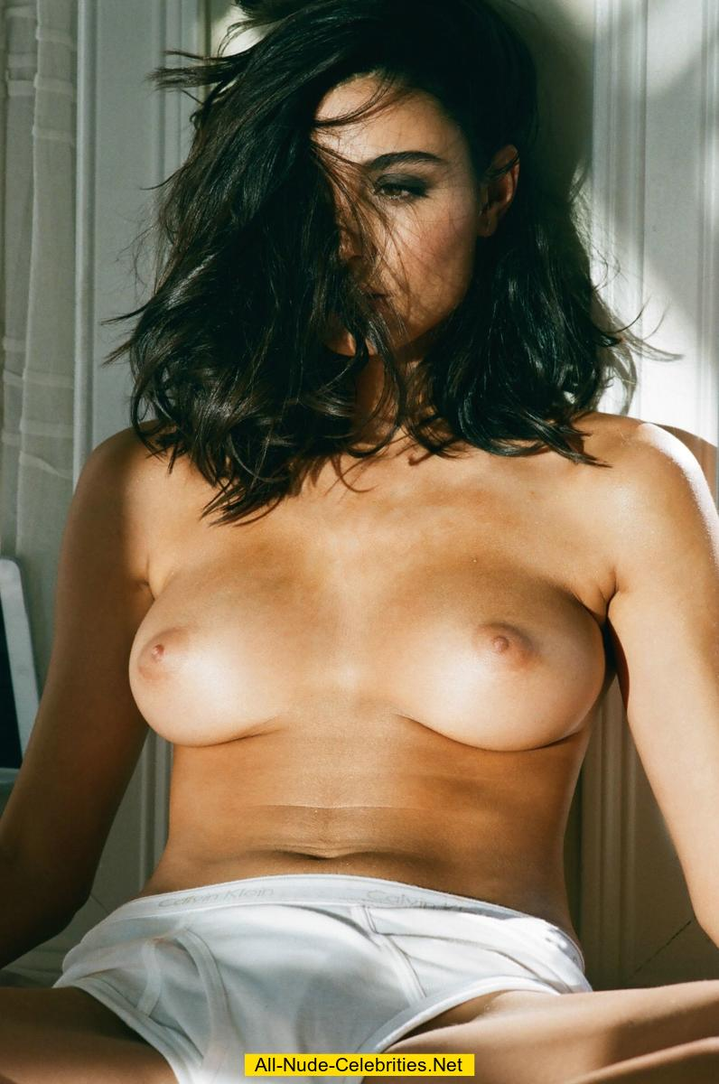 Melina DiMarco posing topless for magazine