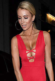 Olivia Attwood deep cleavage in red suit